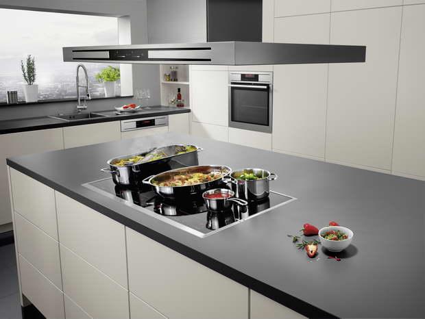 kitchen island modern design,cooking on kitchen island,kitchen design trends,range hood high end,black and white kitchen modern design,