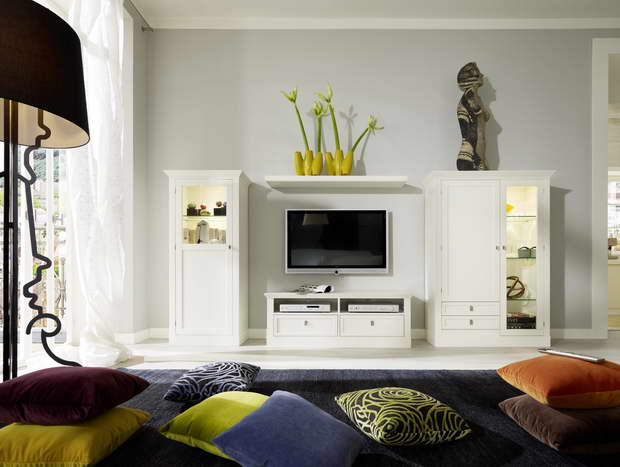 white living room design ideas,decorative cushions for living room,modern interior design,white high end furniture,high end tv unit designs,